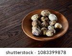 fresh quail eggs in a wooden...   Shutterstock . vector #1083399878