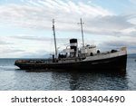 shipwreck of a tug boat from... | Shutterstock . vector #1083404690