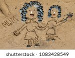 drawing a picture with stones... | Shutterstock . vector #1083428549