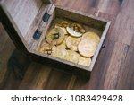 golden bitcoins in the treasure ...   Shutterstock . vector #1083429428