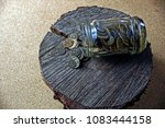 Small photo of Glass jar with a trifle on a wooden stump