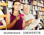 old man is choosing book while...   Shutterstock . vector #1083459278