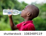 little boy drinking mineral... | Shutterstock . vector #1083489119