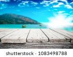 wooden desk space over summer... | Shutterstock . vector #1083498788