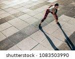female runner doing stretching... | Shutterstock . vector #1083503990