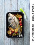 oven baked whole sea fish with... | Shutterstock . vector #1083519053