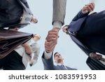bottom view.business handshake | Shutterstock . vector #1083591953