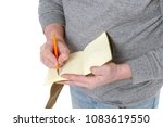 man writes in a vintage notepad ... | Shutterstock . vector #1083619550
