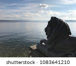 Lion Statue In Front Of A Lake...