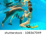 Girl Touches A Dolphin's Nose...