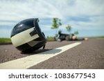 biker helmet lies on street... | Shutterstock . vector #1083677543