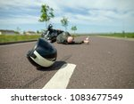 biker helmet lies on street... | Shutterstock . vector #1083677549