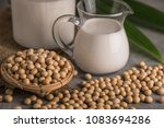 soybeans and milk in soft focus ... | Shutterstock . vector #1083694286