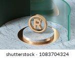 golden registered icon on the... | Shutterstock . vector #1083704324