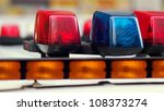 Blue and Red Lights Police Car - stock photo