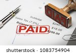 rubber stamp with the text paid ...   Shutterstock . vector #1083754904