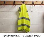green vest hangs on the wall. | Shutterstock . vector #1083845900