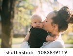 Mother Kiss Little Son With...