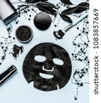 black sheet mask and cosmetic... | Shutterstock . vector #1083857669