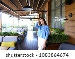 beautiful woman standing at... | Shutterstock . vector #1083864674
