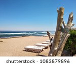sunbed on the beach. coastline...   Shutterstock . vector #1083879896