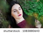 beautiful young brunette with... | Shutterstock . vector #1083880643