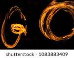 fire dancers swing fire dancing ... | Shutterstock . vector #1083883409