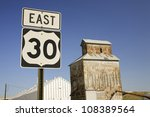 Grain Silo And Road Sign For...