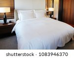 luxury modern hotel bedroom... | Shutterstock . vector #1083946370