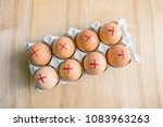 brown farm eggs with red cross... | Shutterstock . vector #1083963263