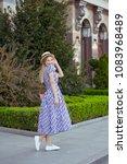 beautiful blonde woman wearing... | Shutterstock . vector #1083968489