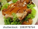 close up of roasted suckling pig | Shutterstock . vector #1083978764