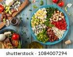 cobb salad.  main dish american ... | Shutterstock . vector #1084007294