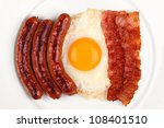 english breakfast on a white dish. - stock photo