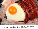 english breakfast cooking in a frypan. - stock photo