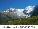 hiking along the glacier of... | Shutterstock . vector #1084035236