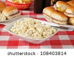 A Bowl Of Macaroni Salad On A...