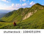 the view with the high rocky... | Shutterstock . vector #1084051094