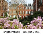 modern townhouses with a... | Shutterstock . vector #1084059458
