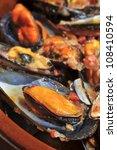 closeup of a plate with mejillones a la marinera, spanish mussels in marinara sauce - stock photo