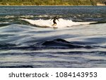 a man wakeboarding on the st.... | Shutterstock . vector #1084143953