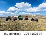 parked atv and utv  buggies on...   Shutterstock . vector #1084163879