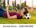 teenager laying on grass with...   Shutterstock . vector #1084186388