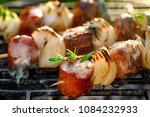 grilled skewers with sausages... | Shutterstock . vector #1084232933