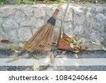 stick broom or coconut broom   Shutterstock . vector #1084240664