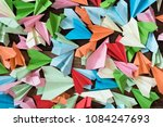colorful paper airplanes on... | Shutterstock . vector #1084247693