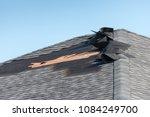 Small photo of Damaged shingle roof