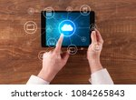 hand touching tablet with cloud ... | Shutterstock . vector #1084265843