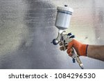 man's hand with a spray gun on... | Shutterstock . vector #1084296530
