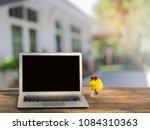 blank screen laptop on table... | Shutterstock . vector #1084310363